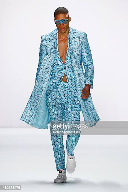 A model walks the runway at the Emre Erdemoglu show during the MercedesBenz Fashion Week Berlin Spring/Summer 2016 at Brandenburg Gate on July 10...