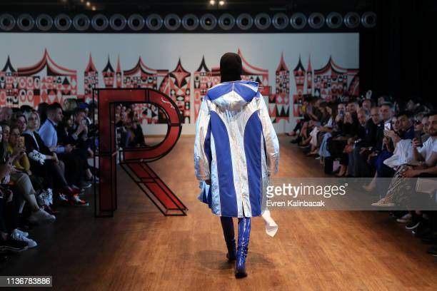 A model walks the runway at the Emre Pakel show during MercedesBenz Istanbul Fashion Week at the Zorlu Performance Hall on March 19 2019 in Istanbul...