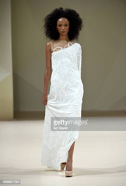 A model walks the runway at the Endemage show during Fashion Forward at Madinat Jumeirah on October 5 2014 in Dubai United Arab Emirates