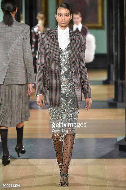 A model walks the runway at the Erdem Autumn Winter 2018 fashion show during London Fashion Week on February 19 2018 in London United Kingdom