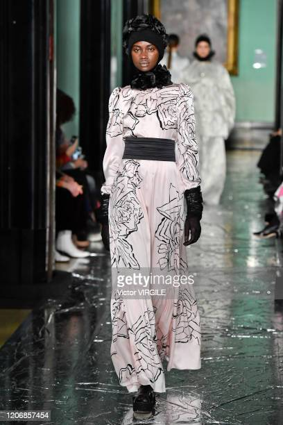 Model walks the runway at the Erdem Ready to Wear Fall/Winter 2020-2021 fashion show during London Fashion Week on February 17, 2020 in London,...