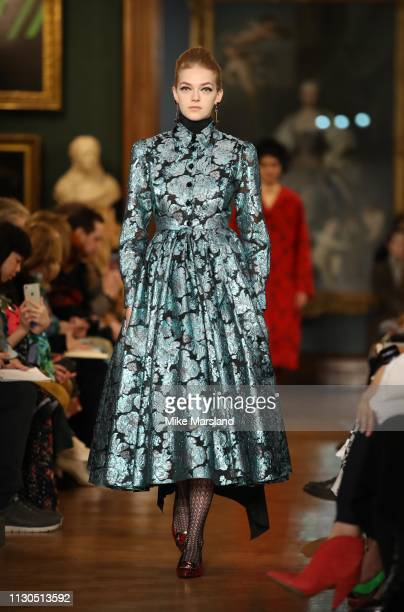Model walks the runway at the Erdem show during London Fashion Week February 2019 at the National Portrait Gallery on February 18, 2019 in London,...