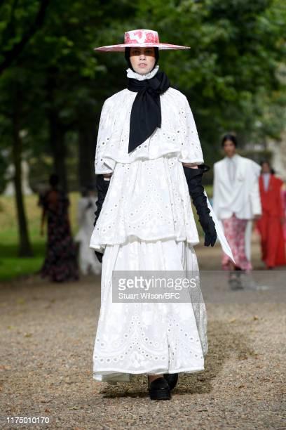 Model walks the runway at the Erdem show during London Fashion Week September 2019 at Grays Inn Gardens on September 16, 2019 in London, England.