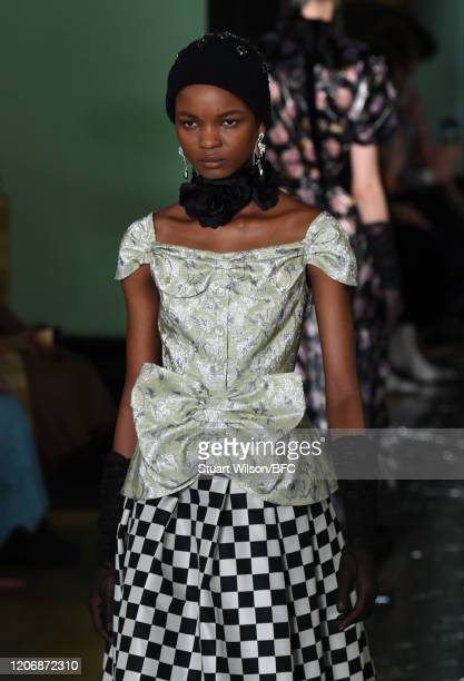Model walks the runway at the Erdem show during London Fashion Week February 2020 on February 17, 2020 in London, England.