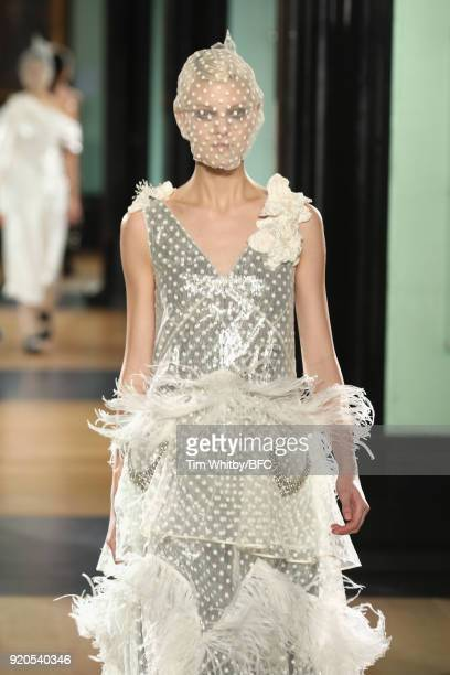 A model walks the runway at the ERDEM show during London Fashion Week February 2018 on February 19 2018 in London England
