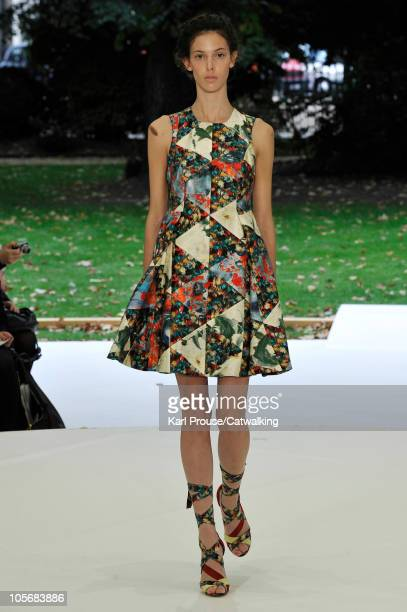 A model walks the runway at the Erdem Spring Summer 2011 fashion show during London Fashion Week at on September 20 2010 in London City