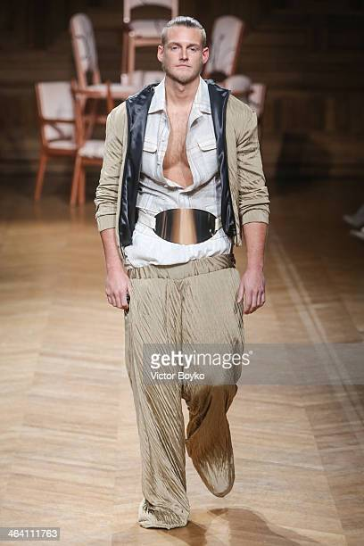 A model walks the runway at the Eric Tilausch show during Paris Fashion Week Haute Couture S/S 2014 on January 20 2014 in Paris France