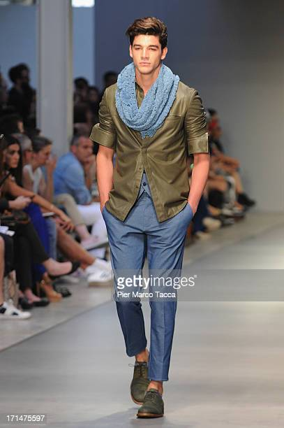 A model walks the runway at the Ermanno Scervino show during Milan Menswear Fashion Week Spring Summer 2014 on June 25 2013 in Milan Italy