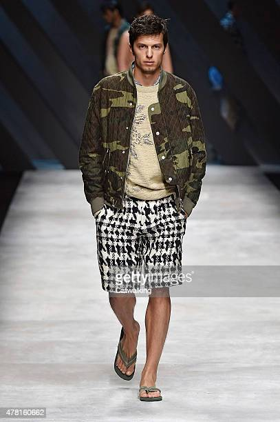 A model walks the runway at the Ermanno Scervino Spring Summer 2016 fashion show during Milan Menswear Fashion Week on June 23 2015 in Milan Italy