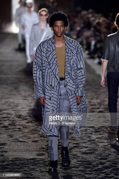 Model walks the runway at the Ermenegildo Zegna fashion show during the Milan Men's Fashion Week Spring/Summer 2020 on June 14, 2019 in Milan, Italy.