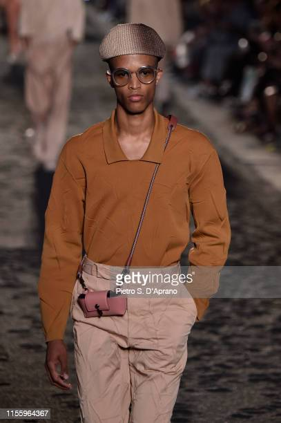 A model walks the runway at the Ermenegildo Zegna fashion show during the Milan Men's Fashion Week Spring/Summer 2020 on June 14 2019 in Milan Italy