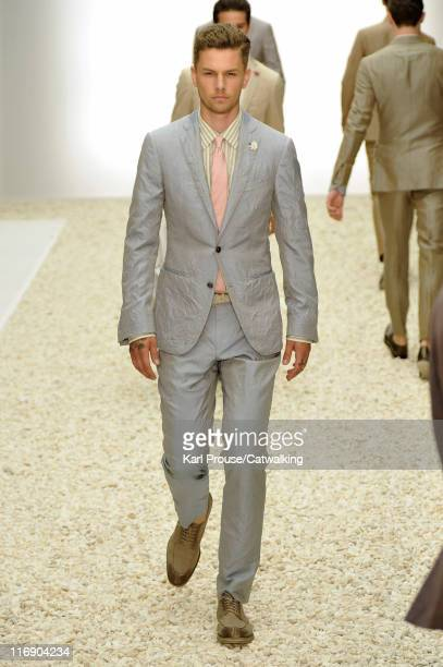 Model walks the runway at the Ermenegildo Zegna menswear fashion show during Milan Fashion Menswear Week on June 18, 2011 in Milan, Italy.
