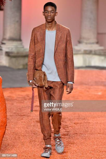 A model walks the runway at the Ermenegildo Zegna show during Milan Men's Fashion Week Spring/Summer 2018 on June 16 2017 in Milan Italy