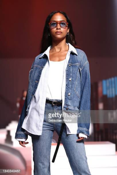 Model walks the runway at the Esprit show during the ABOUT YOU Fashion Week Autumn/Winter 21 at Kraftwerk on September 14, 2021 in Berlin, Germany.