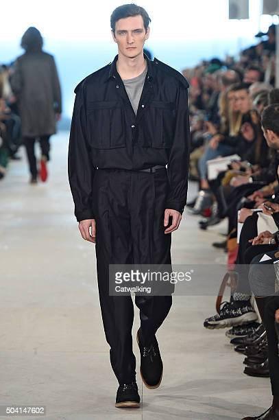 A model walks the runway at the ETautz Autumn Winter 2016 fashion show during London Menswear Fashion Week on January 9 2016 in London United Kingdom