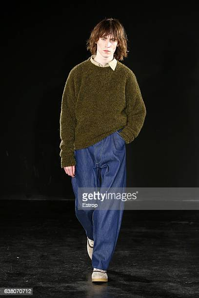 A model walks the runway at the ETautz designed by Patrick Grant show during London Fashion Week Men's January 2017 collections at BFC Show Space on...