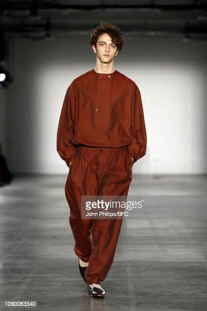 A model walks the runway at the ETautz show during London Fashion Week Men's January 2019 at the BFC Show Space on January 05 2019 in London England