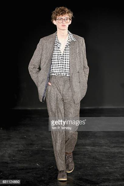 A model walks the runway at the ETautz show during London Fashion Week Men's January 2017 collections at BFC Presentation Space on January 7 2017 in...
