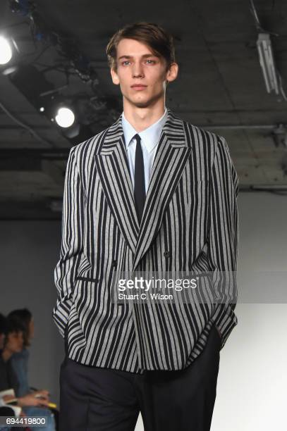 A model walks the runway at the ETautz show during the London Fashion Week Men's June 2017 collections on June 10 2017 in London England
