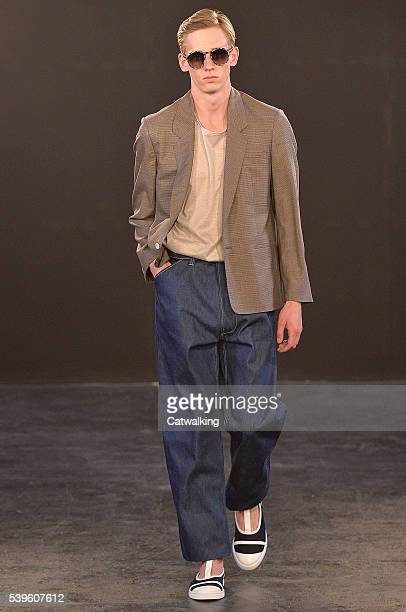 A model walks the runway at the ETautz Spring Summer 2017 fashion show during London Menswear Fashion Week on June 11 2016 in London United Kingdom