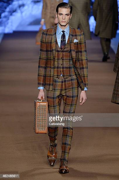 Model walks the runway at the Etro Autumn Winter 2014 fashion show during Milan Menswear Fashion Week on January 13, 2014 in Milan, Italy.
