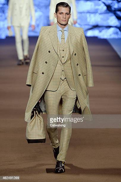 A model walks the runway at the Etro Autumn Winter 2014 fashion show during Milan Menswear Fashion Week on January 13 2014 in Milan Italy
