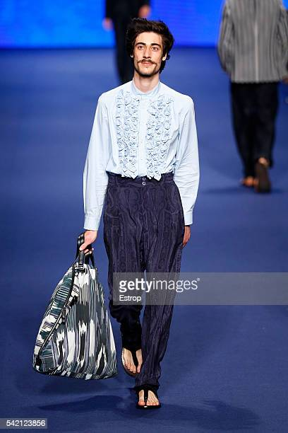 A model walks the runway at the Etro show designed by Kean Etro during Milan Men's Fashion Week SS17 on June 20 2016 in Milan Italy