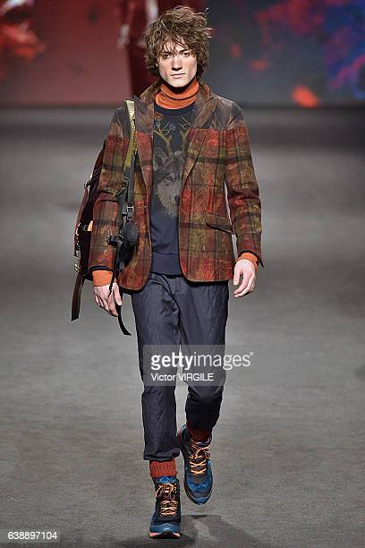 A model walks the runway at the Etro show during Milan Men's Fashion Week Fall/Winter 2017/18 on January 16 2017 in Milan Italy