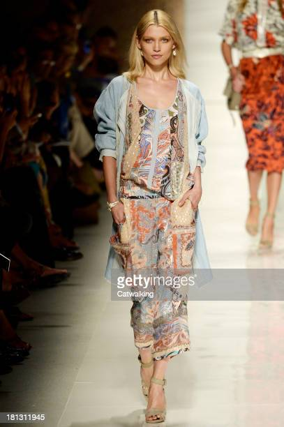 A model walks the runway at the Etro Spring Summer 2014 fashion show during Milan Fashion Week on September 20 2013 in Milan Italy