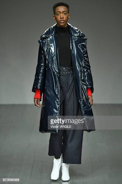 A model walks the runway at the Eudon Choi Ready to Wear Fall/Winter 20182019 fashion show during London Fashion Week February 2018 on February 20...