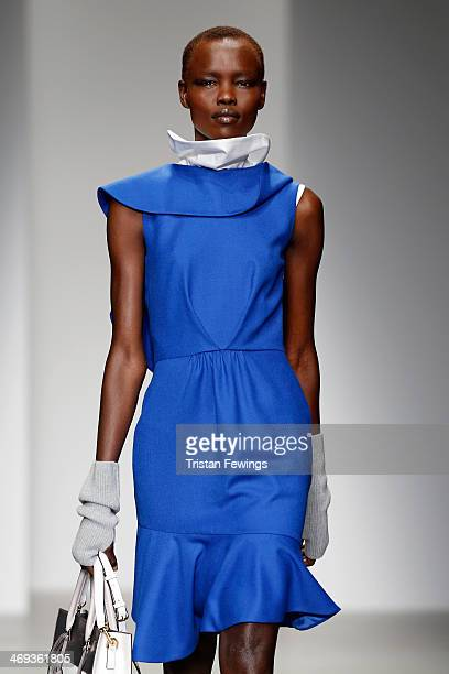 A model walks the runway at the Eudon Choi show at London Fashion Week AW14 at Somerset House on February 14 2014 in London England