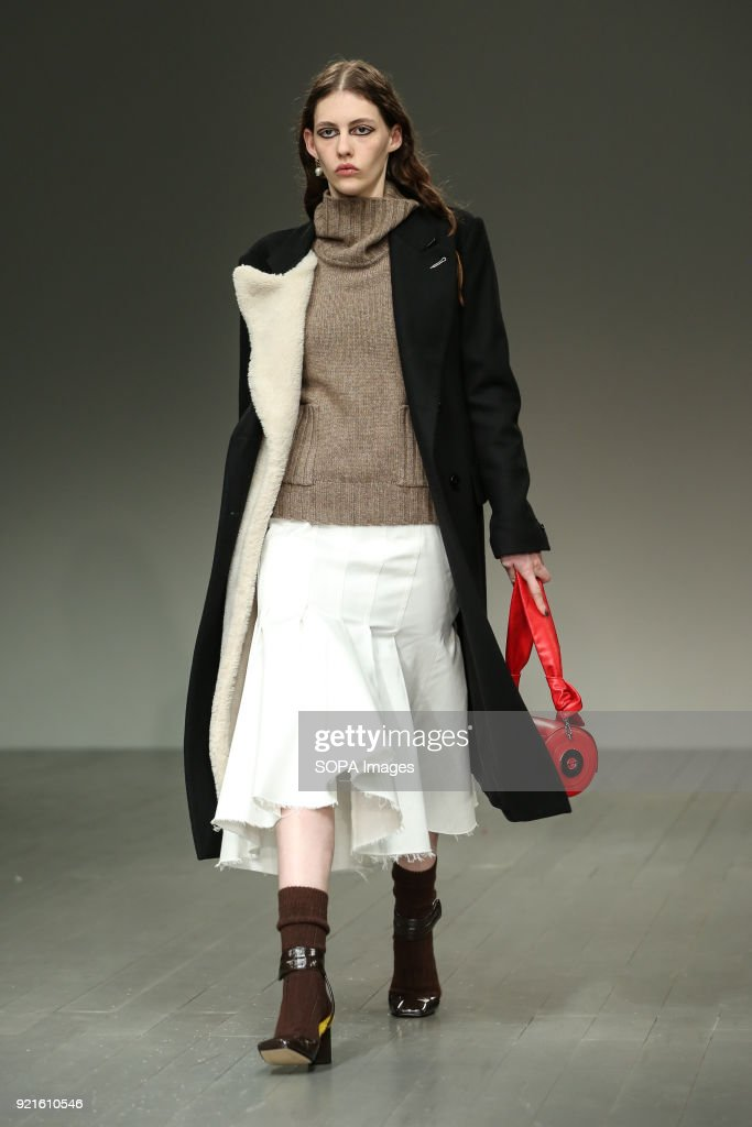 A model walks the runway at the Eudon Choi Show during London Fashion Week February 2018 at BFC Show Space.