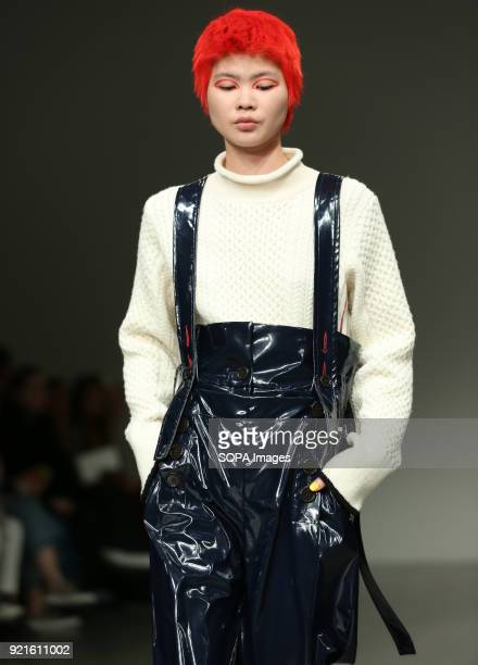 A model walks the runway at the Eudon Choi Show during London Fashion Week February 2018 at BFC Show Space