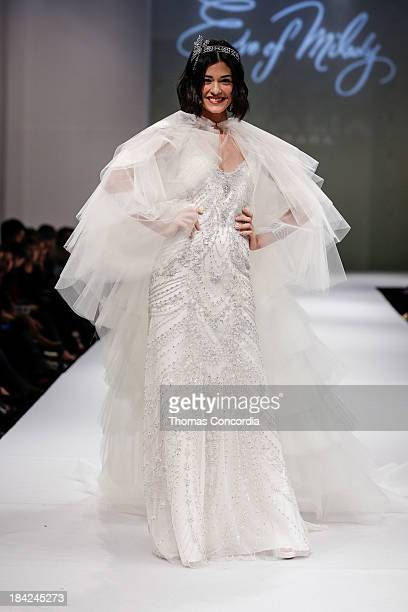 A model walks the runway at the Eve Of Milady Fall 2014 Bridal collection show at Pier 94 on October 12 2013 in New York City