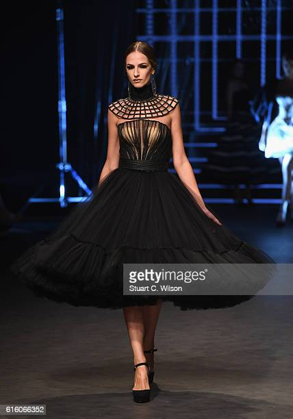 A model walks the runway at the Ezra show during Fashion Forward Spring/Summer 2017 at the Dubai Design District on October 21 2016 in Dubai United...