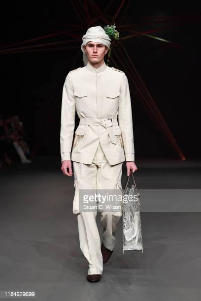 Model walks the runway at the Ezra show during the FFWD October Edition 2019 at the Dubai Design District on October 31, 2019 in Dubai, United Arab...