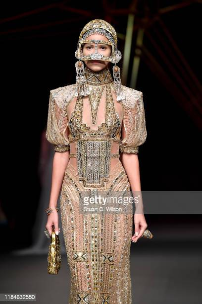 A model walks the runway at the Ezra show during the FFWD October Edition 2019 at the Dubai Design District on October 31 2019 in Dubai United Arab...
