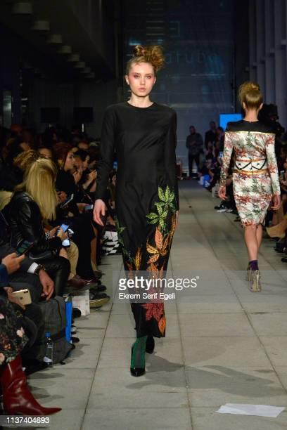 A model walks the runway at the Ezra Tuba show during MercedesBenz Istanbul Fashion Week on March 21 2019 in Istanbul Turkey
