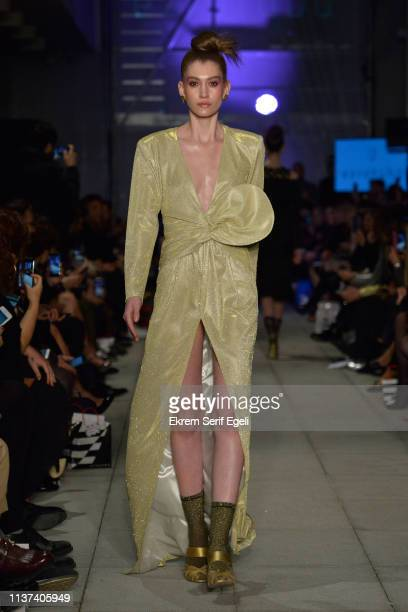A model walks the runway at the Ezra Tuba show during MercedesBenz Istanbul Fashion Week on March 21 2019 in Istanbul Turkey