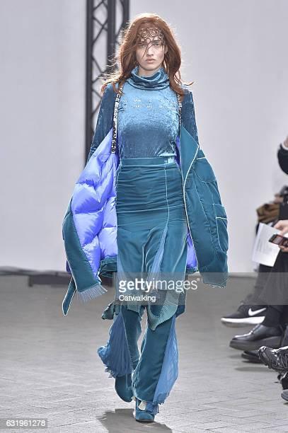 A model walks the runway at the Facetasm Autumn Winter 2017 fashion show during Paris Menswear Fashion Week on January 18 2017 in Paris France
