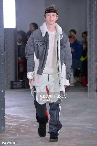 A model walks the runway at the Facetasm Autumn Winter 2018 fashion show during Paris Menswear Fashion Week on January 17 2018 in Paris France