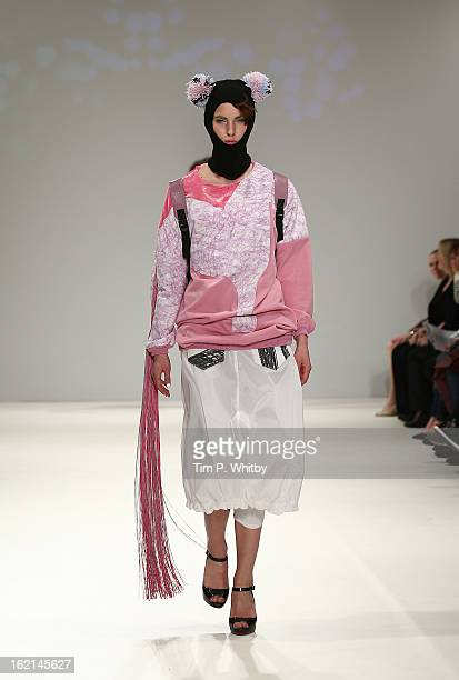 A model walks the runway at the Fad show showcasing designs by fifteen fashion students across the UK during London Fashion Week Fall/Winter 2013/14...