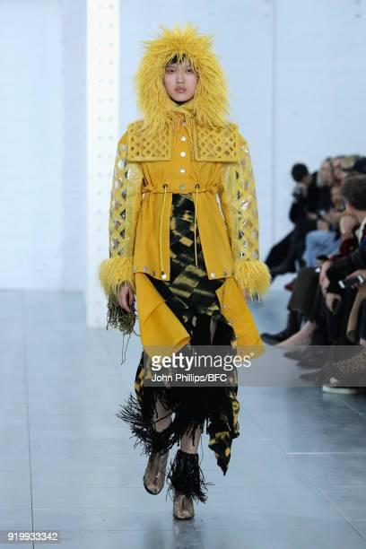 A model walks the runway at the Fashion East ASAI show during London Fashion Week February 2018 at TopShop Show Space on February 18 2018 in London...