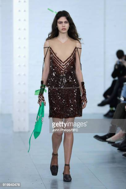 A model walks the runway at the Fashion East Charlotte Knowles show during London Fashion Week February 2018 at TopShop Show Space on February 18...