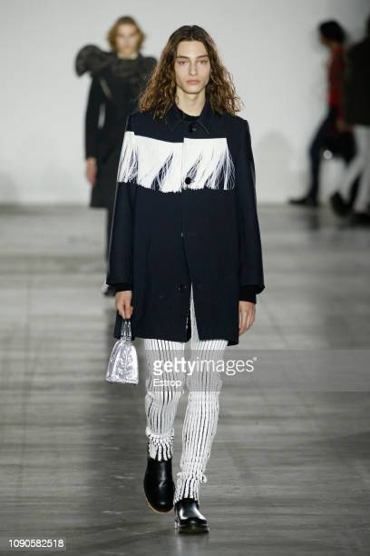 A model walks the runway at the Fashion East / Robyn Lynch show during London Fashion Week Men's January 2019 at the BFC Show Space on January 6 2019...