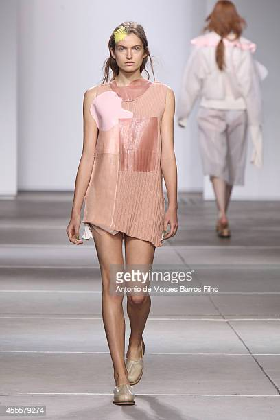 A model walks the runway at the Fashion East show during London Fashion Week Spring Summer 2015 at TopShop Show Space on September 16 2014 in London...