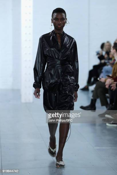 A model walks the runway at the Fashion East Supriya Lele show during London Fashion Week February 2018 at TopShop Show Space on February 18 2018 in...