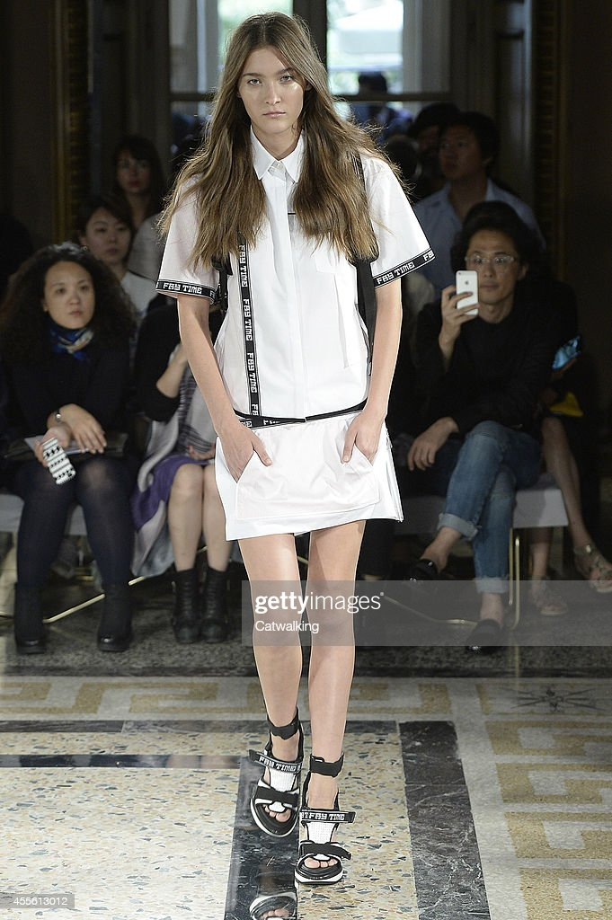 A model walks the runway at the Fay Spring Summer 2015 fashion show ... 7b9107e576e