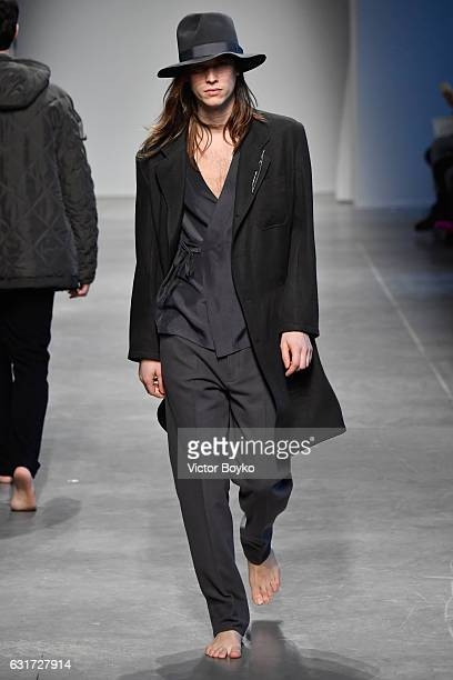 A model walks the runway at the Federico Curradi show during Milan Men's Fashion Week Fall/Winter 2017/18 on January 15 2017 in Milan Italy