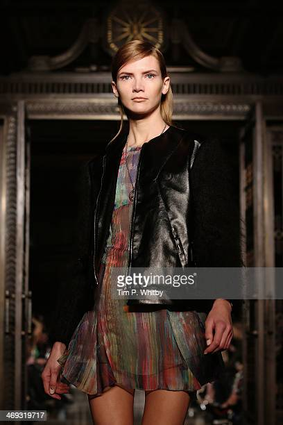 A model walks the runway at the FelderFelder show at London Fashion Week AW14 at Freemasons Hall on February 14 2014 in London England